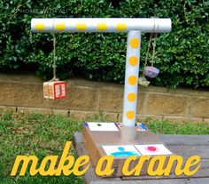 Make a rotating crane from cardboard rolls