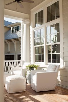 This Watercolor, Florida, home was designed to have tons of light and sprinkled sitting areas throughout—including the porch. - Elegant Homes © / Photo: Emily Jenkins Followill / Design: Courtney Dickey