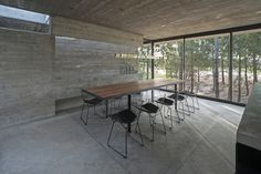 House is a concrete holiday retreat designed by Luciano Kruk in Costa Esmeralda, Buenos Aires, Argentina. Concrete House in Argentina Narrow Staircase, Concrete Architecture, Residential Architecture, Lobby Interior, Concrete Houses, D House, Tiny House, Unusual Homes, Architect Design