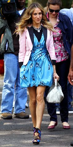Sarah Jessica Parker wearing a Proenza Schouler bubble dress topped with a pink blazer and Nicholas Kirkwood sandals.
