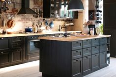 Siobh and Colin's kitchen with mix of blk cup handles and painted knobs