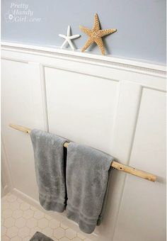 beautiful way to display towels in a beach theme bathroom!