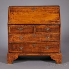 Diminutive Queen Anne Tiger Maple Slant-lid Desk, possibly Connecticut, early 18th century, the thumbmolded lid opens to an interior of eight valanced compartments and four drawers, on a case of two short drawers centering the slide which supports the lid, and two drawers below, all on bracket feet, old refinish, replaced Queen Anne-style brasses, ht. 37, writing surface ht. 26 1/2, wd. 34 3/4, dp. 17 1/2 in.