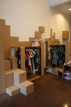 """A store built entirely out of cardboard....well, almost. Given the brief (namely, the words """"Popup"""" and """"Cardboard""""), Musement served up a cashier's table, a changing room with two stalls, a couple of cupboards, and display areas for clothing racks and je…"""