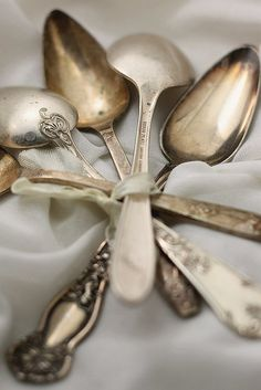 vintage silver spoons wrapped with ribbon and ready for a tea