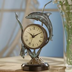 The soothing sight of dolphins playfully swimming around makes this clock a wonderful accessory for your beach home décor, $89.00