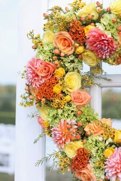 Gorgeous Orange and Yellow Wedding Flower Wreaths by Wildflowers of Tolland