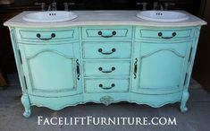 """Curvy French Bathroom Vanity custom painted """"Sweet Rhapsody"""", a light turquoise (Behr, Home Depot) accented with Black Glaze and distressed. Original hardware.  From Facelift Furniture's DIY Inspiration ablum."""