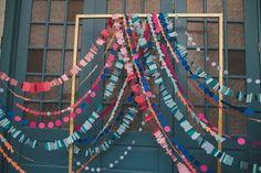 garland ceremony backdrop, photo by Shannon Collins Photography http://ruffledblog.com/maas-building-philadelphia-wedding #weddingideas #backdrops #ceremonies