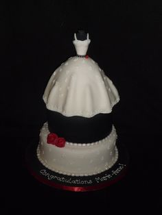 Wedding Shower Dress Cake - I was asked to make a dress cake for a wedding shower that had a very full skirt. The colours were white, black and a bit of red so this is what I came up with. Thanks for looking