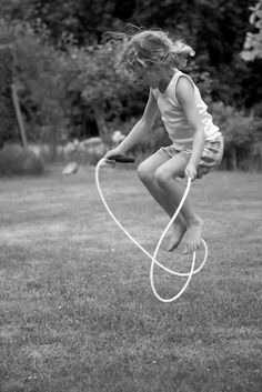 Black & White photo of girl jumping rope- Flies On The Butter
