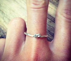 "Sterling Silver Knot Ring Uncovet How cute would this be as an ingagment ring?! :D or a promise ring!! ""i promise to tie the knot with you!"" awwwww<3♥♡"
