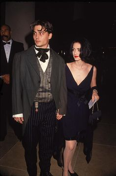 Johnny with Winona Ryder at the Golden Globes on January 19th, 1991