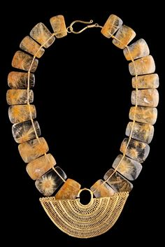Flat Rutilated Crystal Quartz Necklace with Sinu Gold Ear Ornament with Four Registries of False Filigree and ZigZag Pattern Element on the Upper Rim. Colombia, 800-1200 AD.