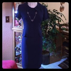 "NWOT Navy Blue 2 Piece suit peplum style Navy Blue short sleeves with Collar with 27.5 "" drop, 6"" back slit. Beautiful color and fully lined . (Necklace not included) Very Cosmo Figure flattering Donna Morgan Dresses"