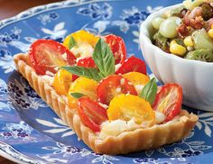 Tomato and basil, one of summer's best flavor combinations, combine in Tomato-Feta Tarts, a savory tart that is perfect for teatime.