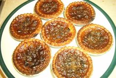 Butter tarts are a Canadian tradition. Waaaay back in the a national contest here in Canada concluded that these butter tarts, originating from Wilkies Bakery in Orillia, Ontario, were the best. I certainly think so and its the only recipe I use. Tart Recipes, Dessert Recipes, Cooking Recipes, Dessert Tarts, Holiday Baking, Christmas Baking, Butter Tart Squares, Canadian Butter Tarts, Canadian Food