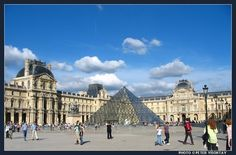 The old royal palace of Louvre with the recently completed glass Louvre Pyramid in the middle.