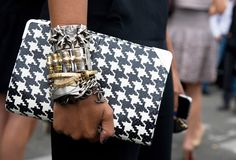 ferragamo clutch at paris fashion week. not to mention the cool jewelry