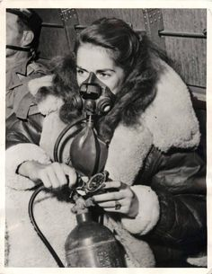 1944- Actress Jinx Falkenburg in oxygen mask as she crosses the Himalayas enroute to entertain U.S. troops in China.