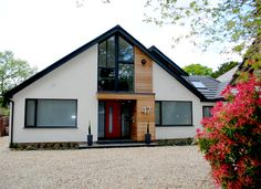 Set back from the road on a generous plot screened by mature trees and hedgerow, this modest chalet bungalow has been transformed into a modern family home. Two small single storey extensions and a roof extension create a generous amount of space at both ground and first floor, including a large boutique style bedroom with ample storage and master en-suite. At ground floor the rooms are spacious and light, with an open plan kitchen, dining and living area to the rear. Full height glazing…