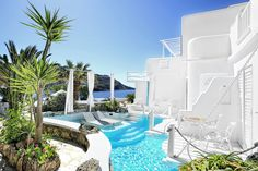 The Kivotos Mykonos Luxury Hotel Royal 2 Bedroom Suite private pool area with a view of Ornos bay