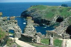 """Tintagel Castle (Cornish: Dintagel, meaning """"fort of the constriction"""") is a medieval fortification located on the peninsula of Tintagel Island, adjacent to the village of Tintagel in Cornwall, England, in the United Kingdom"""