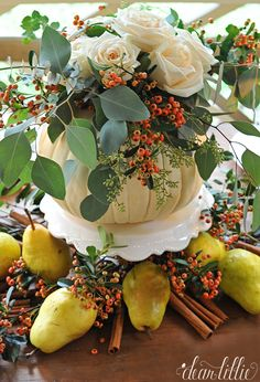 DIY An easy and inexpensive arrangement in a pumpkin vase set on top of a cake stand makes for a perfect Autumn Through Thanksgiving centerpiece.!