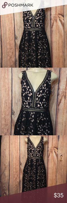 "Gianni Bini black lace dress size L Gianni Bini black and beige dress size L          Measurements laying down.  18"" chest,  16"" waist,  36""length,    100% polyester,   ( Not stretch )     Compared with a size 8        Excellent condition,    Thank you for looking Gianni Bini Dresses Midi"