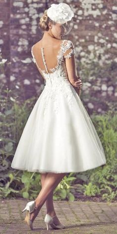 Tea length wedding dress with interesting back detail.