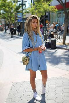 Opt for a baby blue denim shirtdress for a casual-cool vibe. Polish off the ensemble with white canvas high top sneakers.