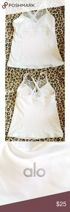 """Alo white yoga/running tank with mesh Alo white yoga tank with built in shelf bra with cups for support, multi shoulder strap for support, mesh for breathability, very stretchy and sturdy tank.Brand name """"Alo"""" on black in reflective letters.Worn once. Ladies large. My items are NOT from a smoke free home* alo Tops Tank Tops"""