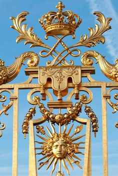 Versailles.  The gates of the Sun King