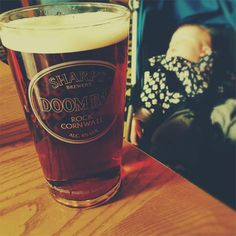 A well-earned pint! This is a picture of a beer and a sleeping baby in a pram