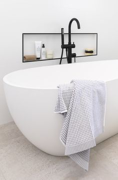 The brief was to create a functional, light filled bathroom that complemented the style of home. The clients' wanted a modern design with colours that convey a sense of calm, a large freestanding bath, that wasn't acrylic and it needed to be achieved within a modest budget. #bathroom #greentiles #freestandingbath #whitetiles #small #bathroomideas #modernbathroom #bathroomlayout #bathroomdecor #bathroomdesign #blacktaps
