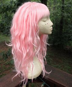 MADE TO ORDER  *May take 6-8 weeks to complete  ! NEW rushed production upgrade for under 4 weeks production! Select as shipping option at checkout  ! NEW international Express Shipping upgrade, received 3-5 days after shipment (customs time may vary). Select as shipping option at checkout  This is a standard cap pastel pink dreadlock wig with feathery bangs and an optional assortment of decor including color complementary wraps, beads, hair rings and thick braids. This wig may also be…