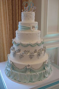 By Sweet Gems Wedding Cakes. Pastel light green or mint, white & silver accents.