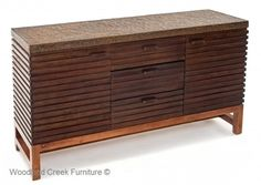 Reclaimed Wood Console with Metal Top by Woodland Creek Furniture. Available in custom sizes, layouts and finishes.
