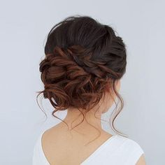 Beautiful romantic messy curled prom or bridal updo from Jouvence Aveda salon.