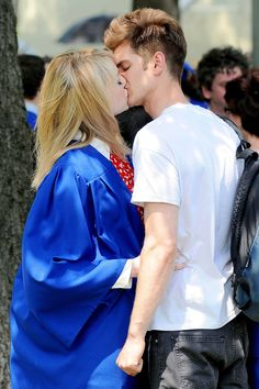 Real-life couple Emma Stone and Andrew Garfield share a kiss on the set of their new film, The Amazing Spider-Man 2, in New York.