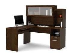 This premium L-shaped desk from Bestar comes in a beautiful chocolate finish with silver handles and frosted glass hutch doors that combine for an elegant look. The return can go on either side,whiche