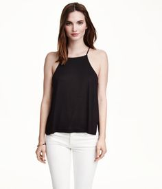Wide-cut camisole top in jersey with narrow shoulder straps, a racer back, and slits at sides.