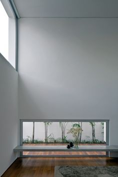 Patio House / AR Arquitetos.  Love window placement, great for multimedia room.