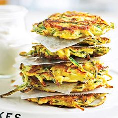 These golden appetizers or dinnertime treats, flavored with Parmesan cheese and onion, will reign as a favorite pancake recipe. The secret ingredient is zucchini.