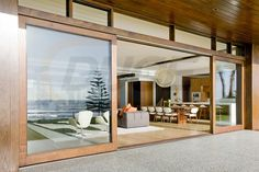 Have a Perfect Exterior Design at Home through Installing Wooden Framed Sliding Patio Doors: Luxurious Beach Residence Exterior With Large Wooden Frame Sliding Glass Doors Timber Sliding Doors, Timber Windows, Timber Door, Sliding Glass Door, Windows And Doors, Glass Doors, Oak Doors, Timber Window Frames, Wooden Glass Door