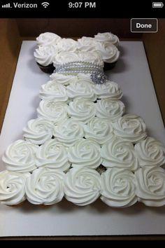 DIY Cupcake Wedding Dress Cake - Do-It-Yourself Fun Ideas Bridal shower idea – Dress shaped Cupcakes Wedding Dress Cupcakes, Bridal Shower Cupcakes, Shower Cakes, Cupcake Wedding, Diy Cupcake, Cupcake Display, Baptism Cupcakes, Cupcake Dress Cake, Rose Cupcake