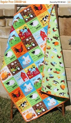 ❘❘❙❙❚❚ ON SALE ❚❚❙❙❘❘     Farm Quilt, Bright Unisex, Tractor Blanket Cows Horses Barn Animals, Country Life, Gender Neutral, Boy or Girl Bedding, Toddler Bed Quilt  Ready to ship! At the Farm! This is the newest line from Leslie Grainger for Robert Kaufman Fabrics. The colors are so bold and fun orange, yellow, red, blue green, and black. This fabric line was so fun to work with and prefect for little ones! You can choose the size baby (40x43) or toddler (40x55). The backing is just as cute…