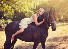 I like this pic but it doesn't look like she loves her gorgeous horse...:(