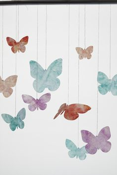 These colorful butterflies made of wax paper bring delight to the nursery.