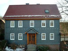 Kunstvolle Schieferfassade mit Bordüre von der Engelhardt Dach & Wand GmbH in Heilbad Heiligenstadt (37308)   Dachdecker.com